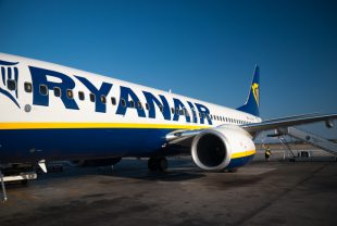 Pisa, Italy - August 6, 2009: Boeing 737-800 in the Pisa Galileo Galilei continental airport standing in the track before landing to the Malta Island . The airplane was Boeing 737-800 of RyanAir Company . The RyanAir is an airline operates flights to Europe city.
